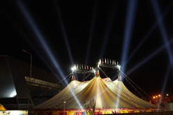 the circus dome in the rays and lights night view