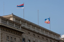 The City Assembly of Belgrade, capital of Serbia, with flags of Serbia and Belgrade