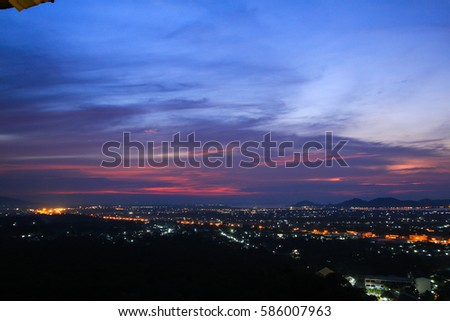The city lights at dusk on the view point #586007963