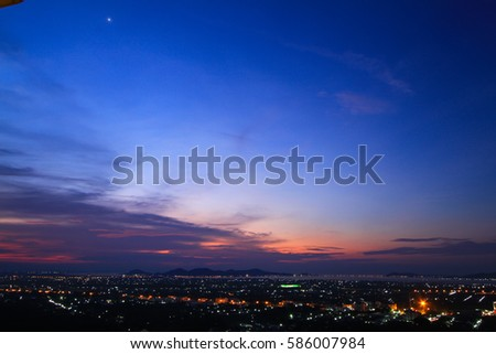 The city lights at dusk on the view point #586007984