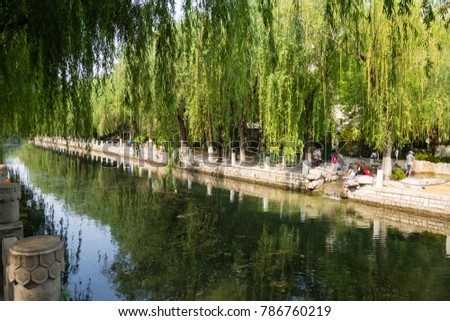 The city Moat that runs around the old city of Jinan, connecting Daming Lake, Quancheng Square and the famous Baotou Spring #786760219