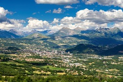 The city of Gap in Summer with view of the distant mountains of the Ecrins National Park massif. Hautes-Alpes in the French Alps. France