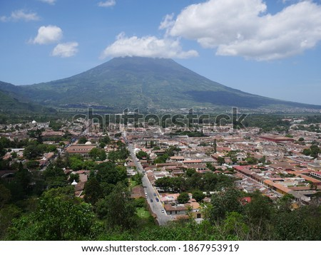 Photo of  The city of La Antigua is located at the foot of the Agua volcano in the Panchoy Valley. The place is located in the central highlands of Guatemala by the three volcanoes Agua, Acatenango and Fuego.