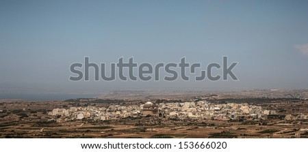 The city of Mgarr and its church from the hill of Bingemma.