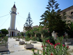 The city of Zakynthos. Streets and attractions of the island. Church of St. Dionysius, bell tower, port. Zakynthos Island, Greece