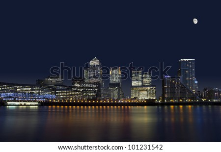 The cityscape of Canary Wharf in London at night.
