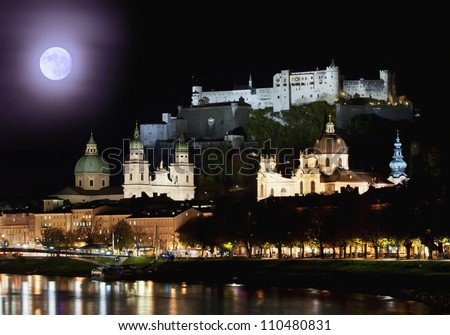 The cityscape of Salzburg over the river at night