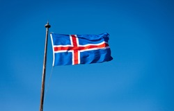 The civil national flag of Iceland is blue as the sky with a snow-white cross, and a fiery-red cross inside the white cross.