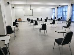 The classroom chairs are 6 feet apart, according to the principle of physical distancing.