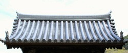 The clay roof of a Japanese temple gate