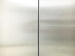The clean stainless elevator doors.
