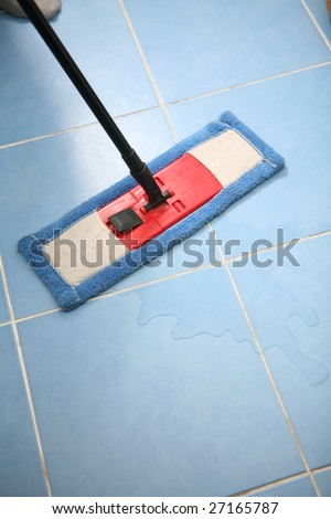 The cleaner washes a floor.