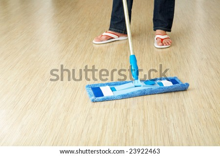 The cleaner washes a floor in premises