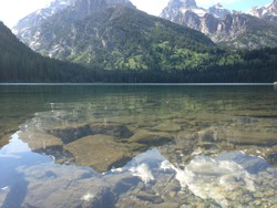The clear waters of Taggart Lake in Grand Teton National Park below the Grand Tetons