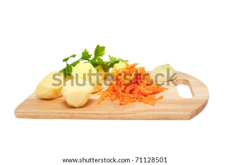 The cleared potato, the onions, grated carrots and fresh parsley on a chopping board. Components for soup on a white background