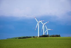 The clearest photos of the harmony of wind turbines with nature. Great timing on a rainy day.