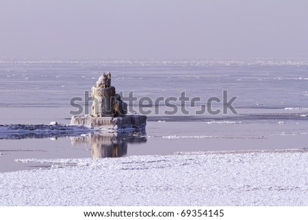 The Cleveland Harbor West Pierhead Lighthouse covered in ice. The lighthouse, built in 1911, guides ships from Lake Erie into the Port of Cleveland and the Cuyahoga River.
