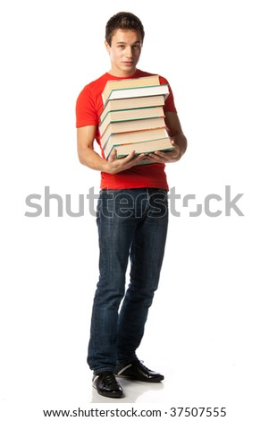 The clever young man holds in hands a pile of books on a white background.