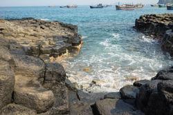 The Cliff of Stone Plates Da Dia (Ghenh Da Dia) in Central Vietnam, seashore area of uniformly interlocking basalt rock columns, created from volcanic eruptions millions of years ago
