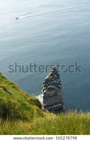 The Cliffs of Moher (Ireland) with a boat
