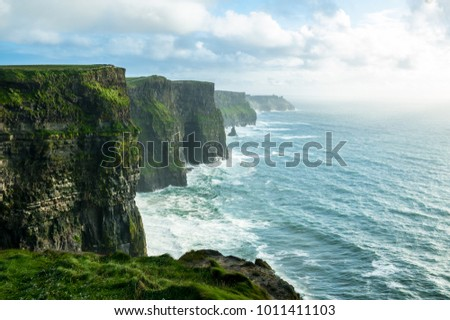 The Cliffs of Moher, Irelands Most Visited Natural Tourist Attraction, are sea cliffs located at the southwestern edge of the Burren region in County Clare, Ireland. Stock fotó ©