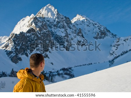 The climber looks at high mountain