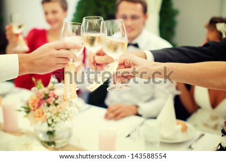 The clink of glasses. wedding reception
