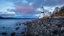 The Cloch lighthouse is on the shore of the Firth of Clyde, Scotland. It is situated low down on the E shore of the Firth of Clyde a short distance SW of Cloch Point.