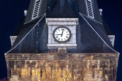 The clock of the oldest church in the city of Enschede in the Netherlands point 21.00 hours. The time of the curfew in the Netherlands during covid-19.