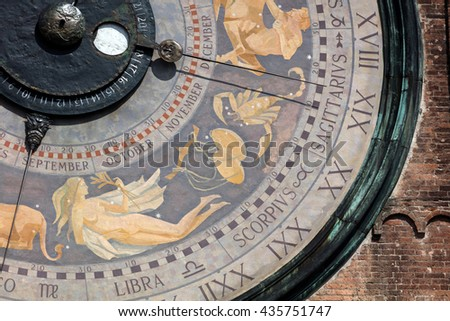 The clock on the Torrazzo tower is the largest astronomical clock in the world, painted by Paolo Scazzola in 1483, shows the sky with zodiac constellations and the Sun and Moon moving through them. #435751747