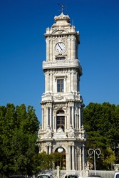 The clock tower Dolmabahce (Dolmabahce Saat Kulesi) lockated in Besiktas historic centre near Bosphorus, Istanbul, Turkey