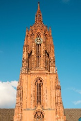 The clock tower of the gothic architecture of Saint Bartholomeus's Cathedral, Frankfurt, Hesse, Germany