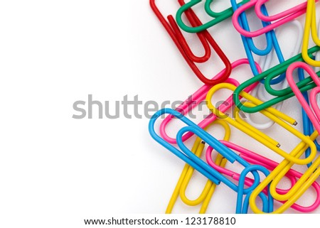 the close up of colorful clips on white background