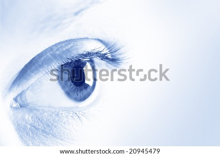 The close up of eye. Blue background