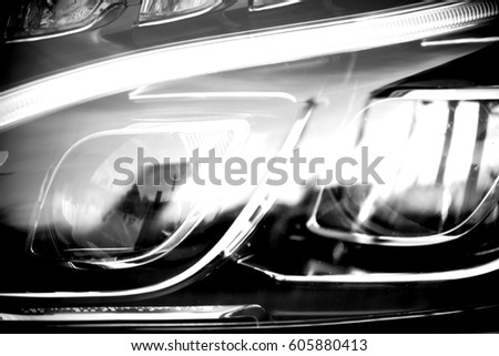 The close-up of the front light of a motor vehicle with neon headlights / Neon headlights           #605880413