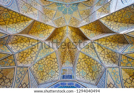 The close-up of the muqarnas (honeycomb) arch of the West portal of Jameh mosque, the brick cells are covered with intricate mosaic patterns, Isfahan, Iran. #1294040494