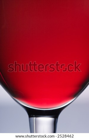 The close up of the red wine glass