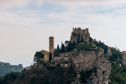 The close-up view of a medieval fortified castle of an old French village named Èze on top of a cliff in the Alps mountains (Côte d'Azur)