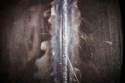 The close up weld on a steel pipes for a new heat line.