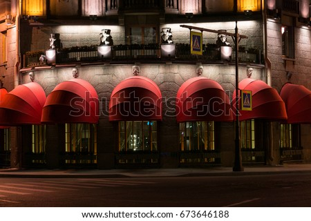 The closed doors and windows of a restaurant in the night