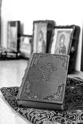 The closed religious Orthodox book in the old church language lies in the church in front of the icons, during the Orthodox liturgy. The concept of Orthodoxy.