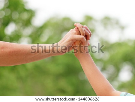 The closeness of mother and son - touch (contact)