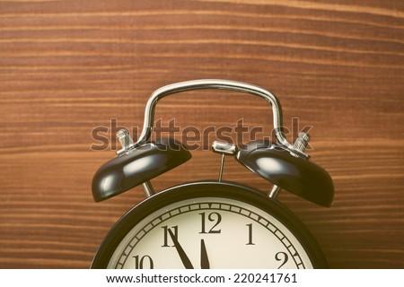 the closeup of analog retro alarm clock