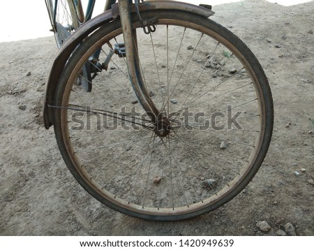 The closeup view of a parked vintage bicycle front tyre. Alphabet photography letter O. Photo O - Alphabet photography - Bicycle Theme - Alphabet photo letters - Alphabet print