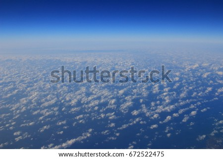 the  Cloud formations seen from the plane #672522475