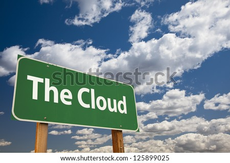 The Cloud Green Road Sign Over Clouds and Sky.
