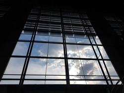 The clouds and the sky outside the dark building.