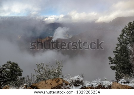 The clouds rising in the Grand Canyon after a blizzard, just in time for the sun to begin to set