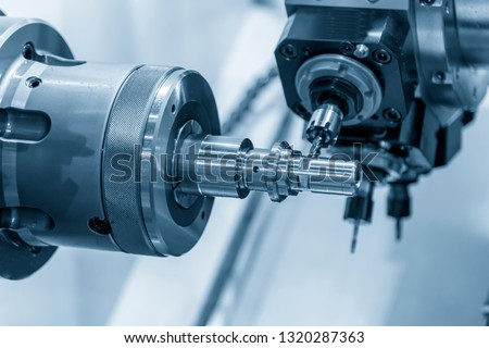 The CNC lathe machine cutting  the slot groove by milling turret .Hi-technology automotive part manufacturing process.