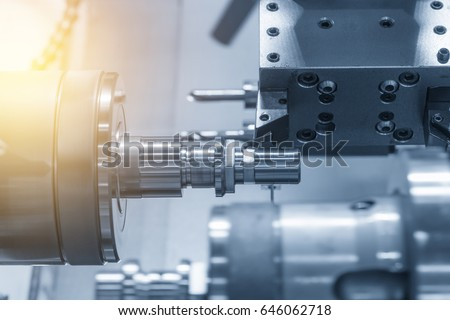 The CNC lathe machine (Turning machine) while drilling the metal rod with the drill and center drill tool .The hi-technology machining concept. #646062718